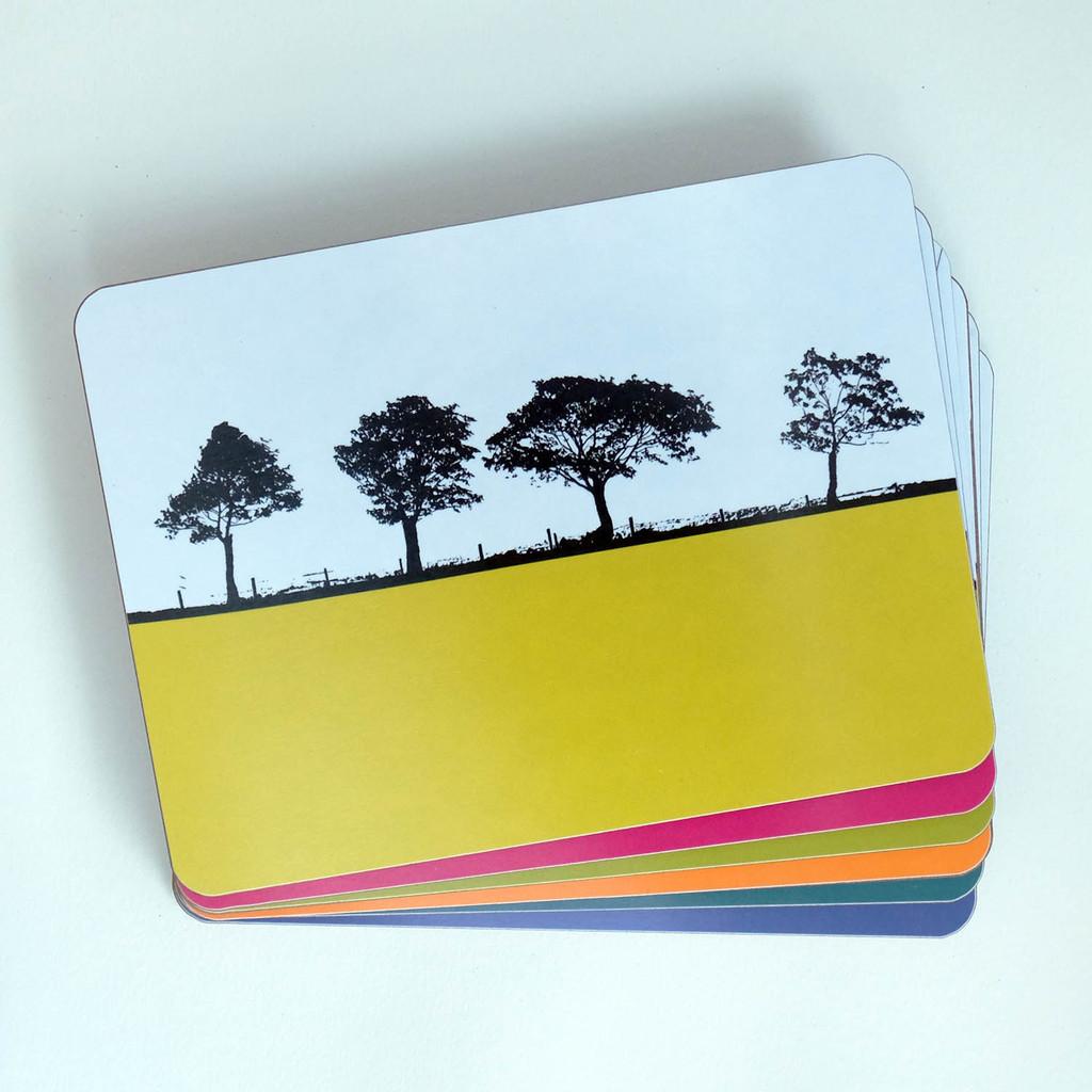 Tree silhouette landscape set of placemats by Jacky Al-Samarraie