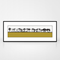 Landscape print of Northumberland countryside by designer Jacky Al-Samarraie.  The print colour is mustard.  The print comes mounted but is shown in a frame for reference.