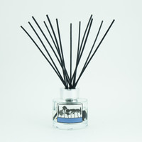 Pomegranate and black pepper scented reed room diffuser by designer Jacky Al-Samarraie