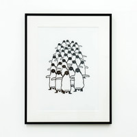 Framed Penguin print on wall - by Jacky Al-Samarraie