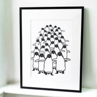 Small penguin screen-print in black frame