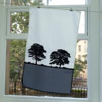 Cotton tea towel with tree design by Jacky Al-Samarraie in grey.