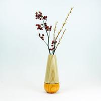 Orange tear drop wood stem vase by designer Jacky Al-Samarraie