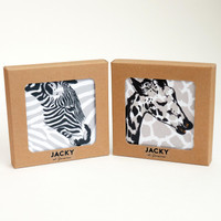 Two boxed coaster gift sets of four wild animals by Jacky Al-Samarraie