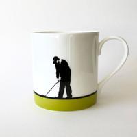 Green golfing mug by Jacky Al-Samarraie