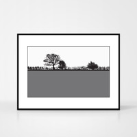Landscape print of Pool in Wharfedale, West Yorkshire by designer Jacky Al-Samarraie.  The print colour is grey.  The print comes mounted but is shown in a frame for reference.