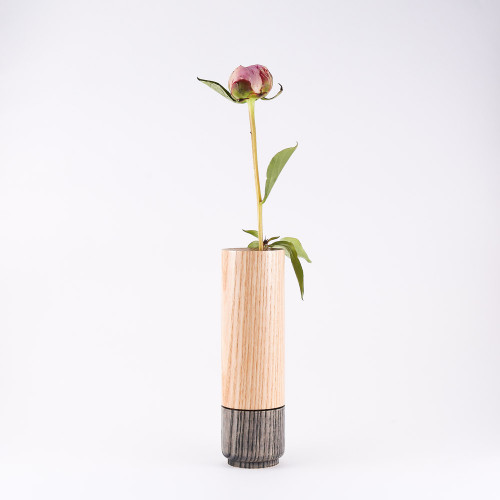 Grey wood stem vase by designer Jacky Al-Samarraie, with flowers in glass tube