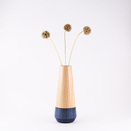 Blue wood stem vase by designer Jacky Al-Samarraie, with flowers in glass tube