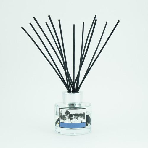 Pomegranate and black pepper scented reed room diffuser by designer Jacky Al-Samarraie