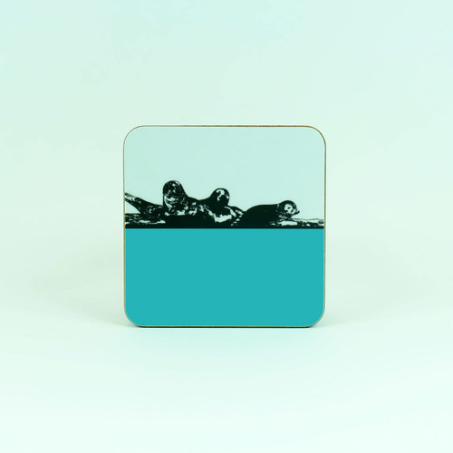 Norfolk drinks coaster in light blue - Seals at  Blakeney Point by Jacky Al-Samarraie
