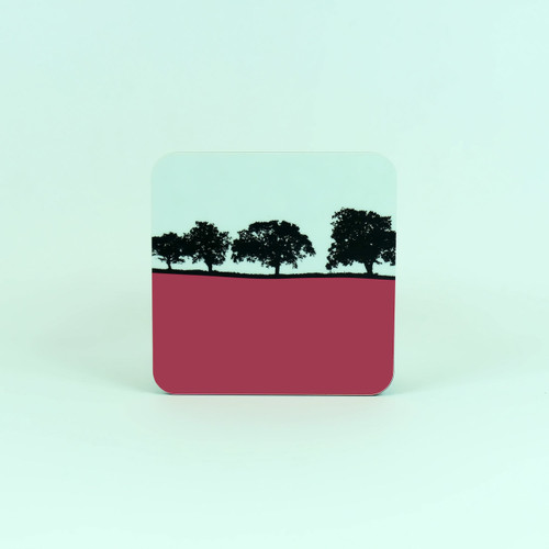 Pink square drinks coaster by Jacky Al-Samarraie. Landscape of Holt countryside, Norfolk.