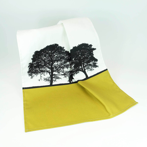 Mustard cotton tea towels with tree landscape design by Jacky Al-Samarraie