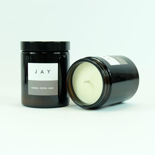 Black Pepper & Lemon candle in brown glass jar. By Jacky Al-Samarraie