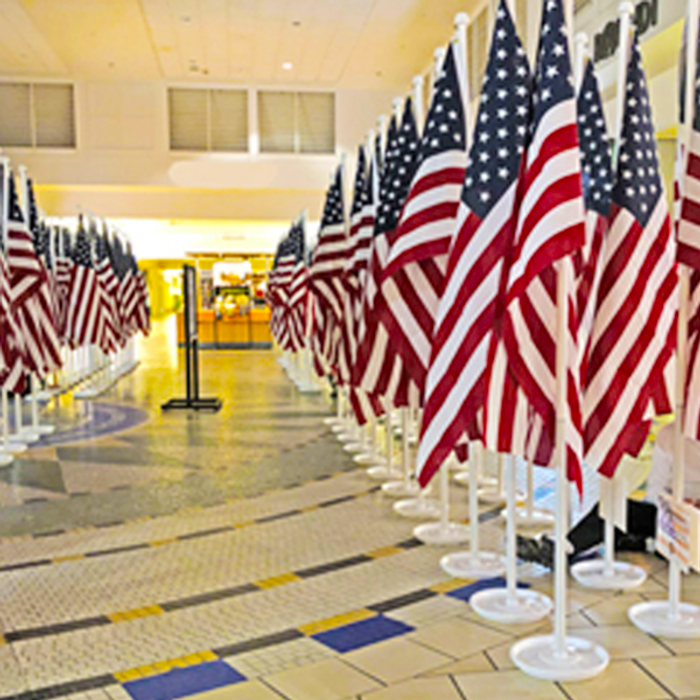 Rows of Indoor American Flagpole Sets  in Building