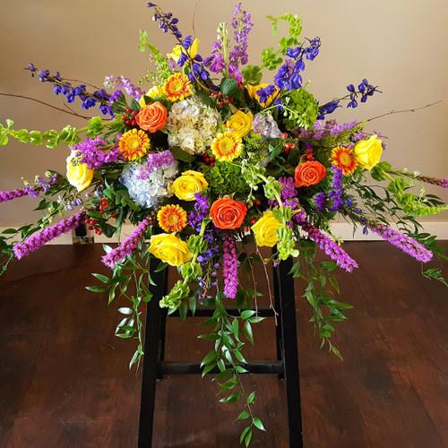 Colorful Tribute Casket Spray Sympathy Flowers Midwood Flower Shop | Charlotte Florist Delivery Service