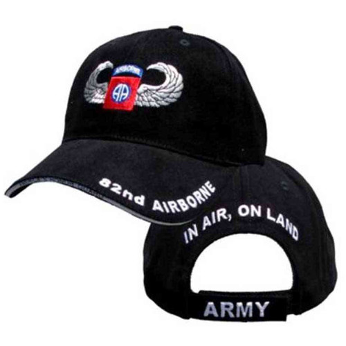 army 82nd airborne jump wings hat in air on land
