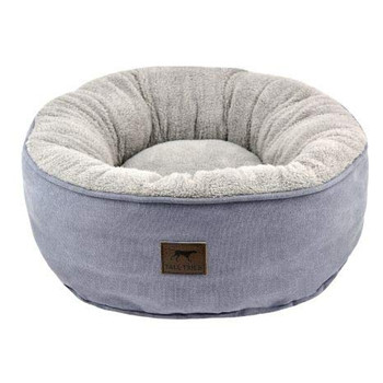 """Small Donut Bed measuring 18"""" x 18"""" Recommended for dogs up to 25lbs who enjoy nesting, burrowing and curling while resting. Reversible design allows for custom comfort. Filled with 100% post consumer recycled poly-fiber. Pair with a Tall Tails Blanket for an extra layer of great comfort. Machine washable and dryable."""
