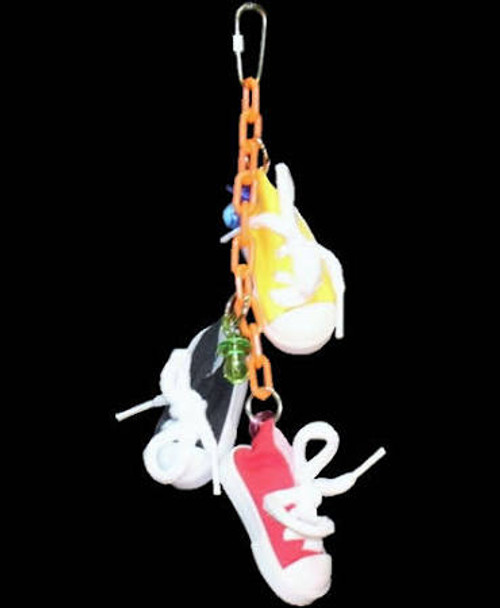 Sneakers On A Line Bird Toy Has Three Sneakers With Acrylic Pacifiers All Hung On Plastic Chain. Each Sneaker Can Be Filled With Your Bird's Favorite Treats.