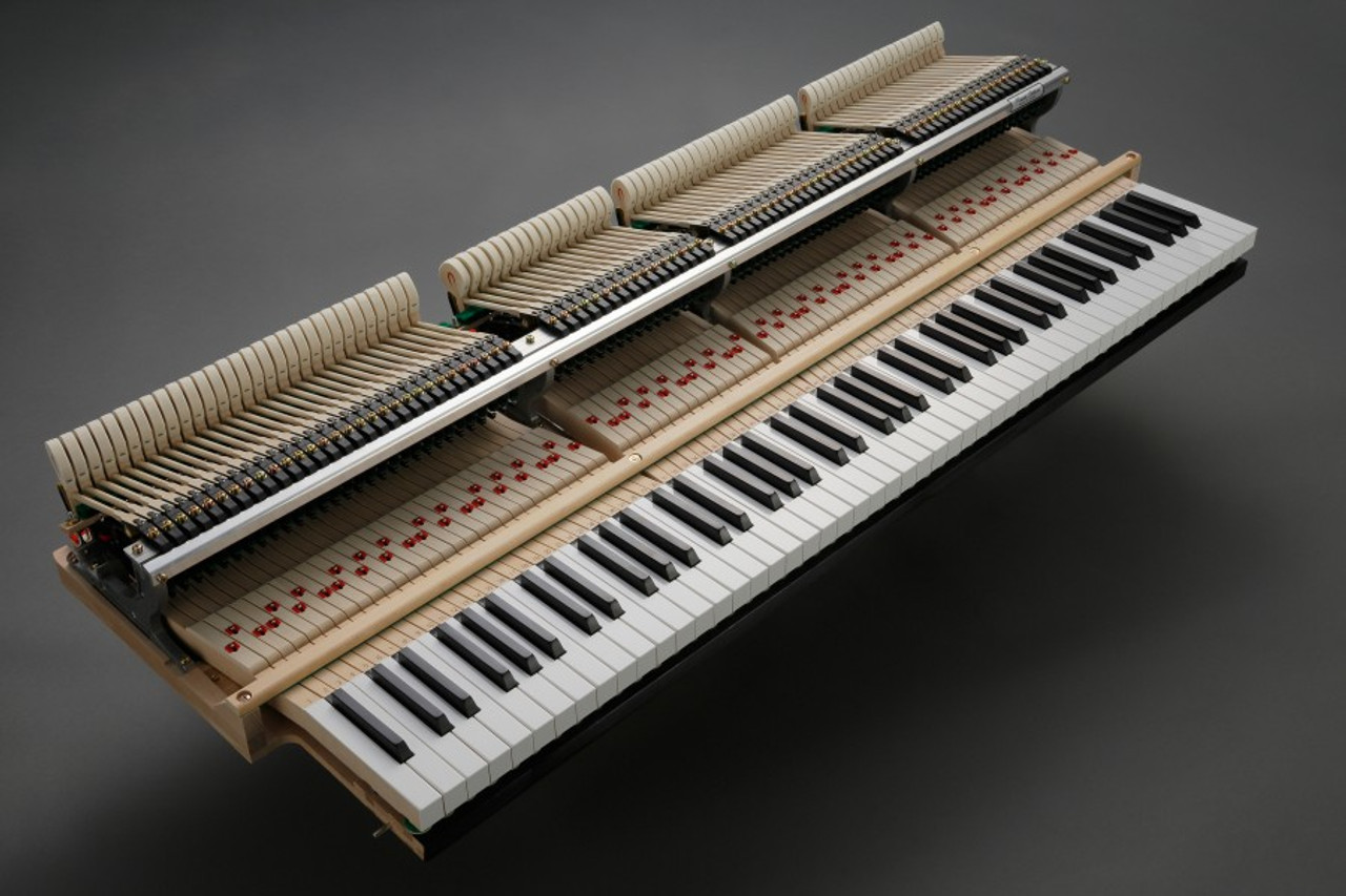 The Melennium III Grand action, with longer keys.