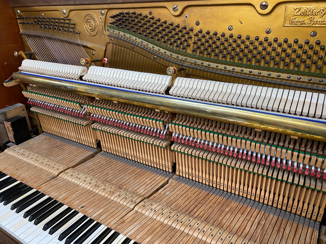 Zeiter & Winkelmann Player Piano. The piano action has been fully restored, including new German hammers felts, leathers and dampers, giving this piano a new lease on life. More importantly in order to have the player mechanism functioning properly.