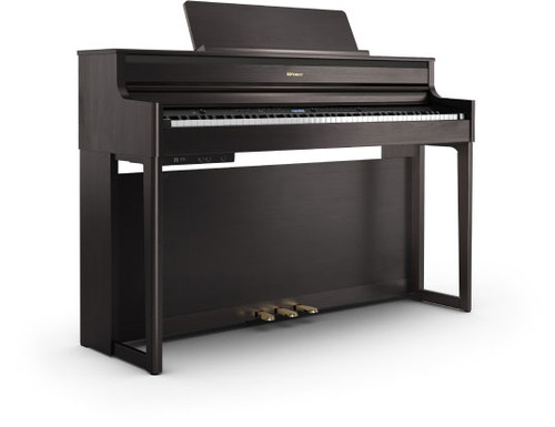 HP704 Premium look and authentic piano touch with four-speaker audio system The HP704 provides the style, performance, and pristine sound projection you'd expect from a premium studio piano. With its sleek, sophisticated cabinet design, this digital piano makes a statement wherever you play it—and a range of finishes ensures it fits in anywhere. The advanced PHA-50 keyboard, onboard tutorial features, and Bluetooth connectivity with music apps mean you'll always be inspired to play, explore and improve. And the tall, elegant cabinet houses a powerful four-speaker audio system that delivers dynamic, room-filling sound as you perform—or while you relax by streaming your favorite tunes.