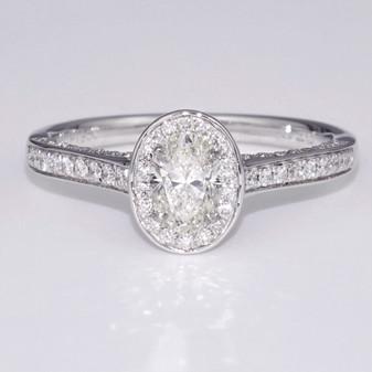Platinum oval cut diamond halo ring