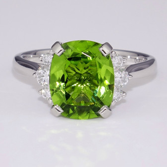 Platinum rectangular cushion cut peridot and diamond ring
