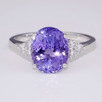 18ct white gold oval cut tanzanite and round brilliant cut diamond ring