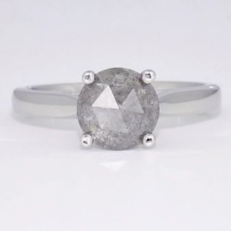 Platinum salt and pepper diamond solitaire ring