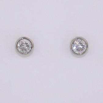 9ct white gold diamond solitaire stud earrings in rubover settings ER10921