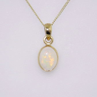 9ct yellow gold oval opal pendant with rubover setting PE5213