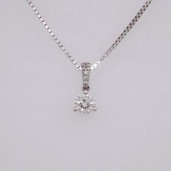 9ct white gold diamond solitaire pendant in three claw setting with diamond-set bail PE4736