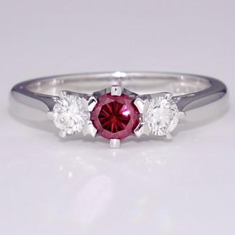 18ct white gold diamond trilogy ring with treated fancy vivid purplish pink centre diamond