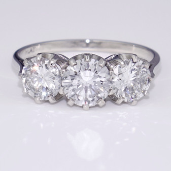 Pre-owned platinum diamond trilogy ring