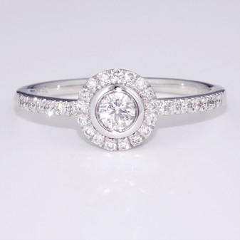 18ct white gold diamond halo ring with diamond-set shoulders GR4104
