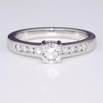 Platinum diamond solitaire ring with diamond-set shoulders GR3134