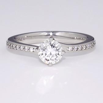 Platinum round brilliant cut diamond solitaire twist ring with diamond-set shoulders GR5268