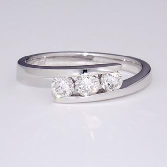 Platinum three diamond channel set twist ring GR3331