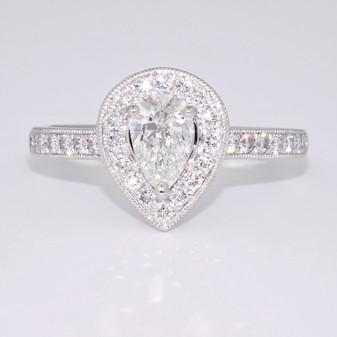 Platinum pear cut diamond halo ring with diamond-set shoulders GR5792