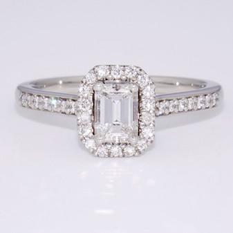 Platinum emerald cut diamond halo ring with diamond-set shoulders GR5685