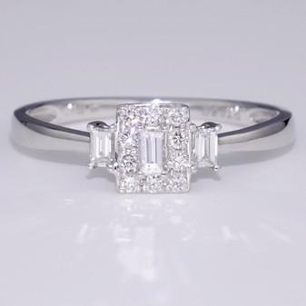 Platinum baguette and round brilliant cut diamond cluster ring