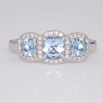 Platinum aquamarine and diamond cushion cut triple halo ring