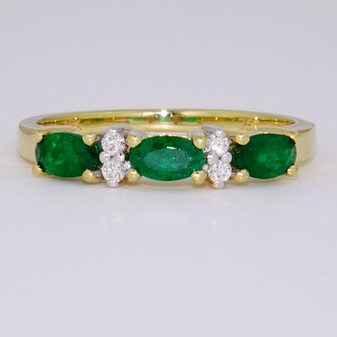 18ct gold oval cut emerald and round brilliant cut diamond ring