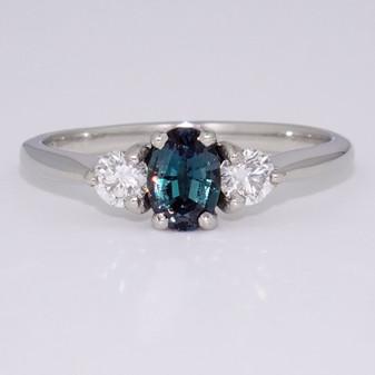 Platinum oval cut alexandrite and round brilliant cut diamond ring