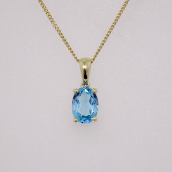 9ct gold fancy oval cut blue topaz pendant