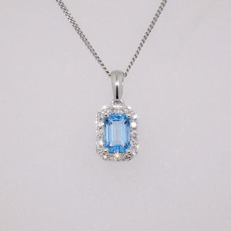 9ct white gold emerald cut blue topaz and diamond cluster pendant