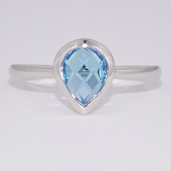 9ct white gold fancy pear cut blue topaz rubover ring