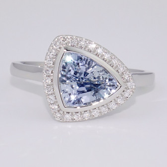 Unique unheated oblique triangular sapphire and diamond cluster ring