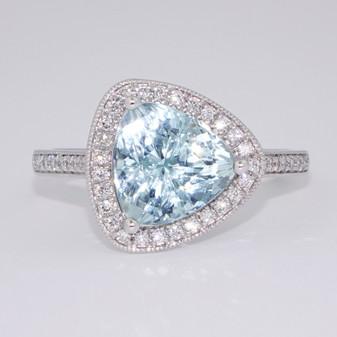 Platinum trillion cut aquamarine and diamond cluster ring with diamond-set shoulders
