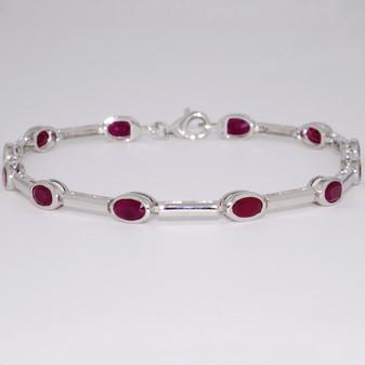 9ct white gold oval cut rubover set ruby bracelet
